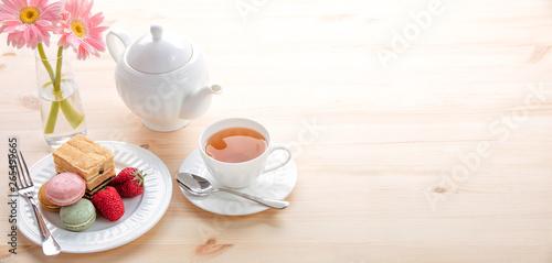 Fototapeta macarons and tea for dessert obraz