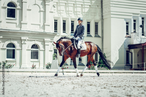 Nice skilled rider going forward on a horse Fotobehang