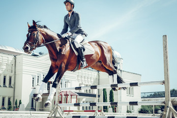 Nice handsome man jumping over the barrier