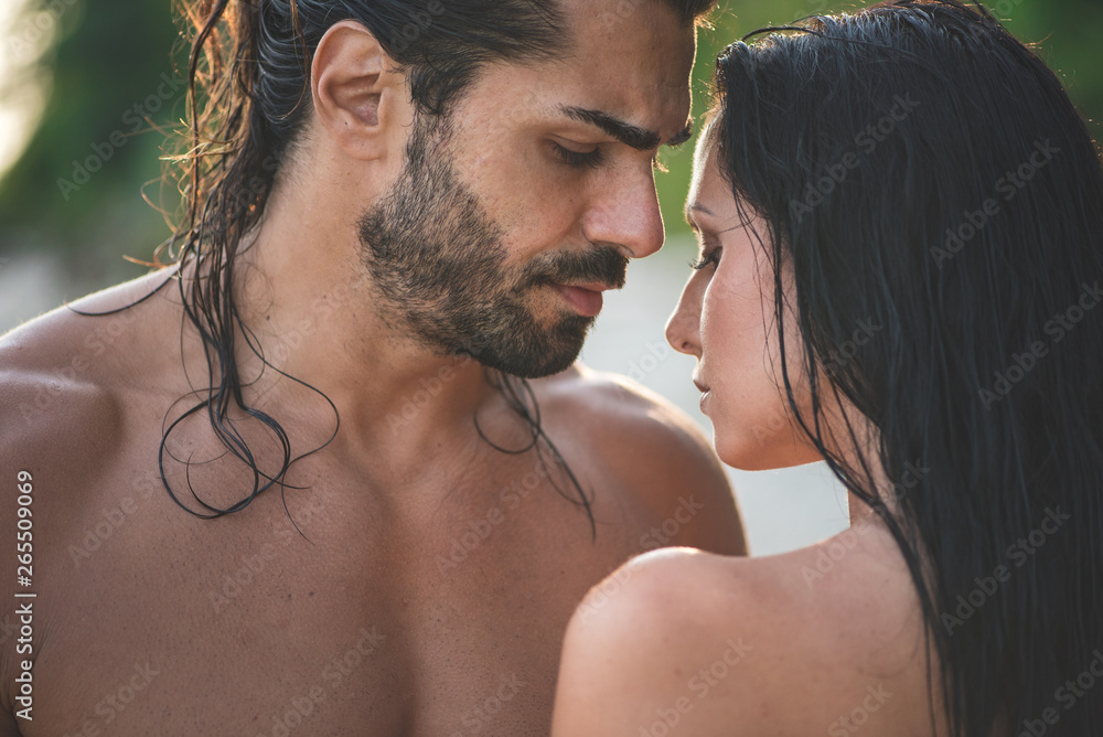 Fototapeta Loving couple topless with dark long hair is standing next to each other. The man is bearded