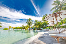 Luxury Swimming Pool In The Tropical Hotel Or Resort. Palm Trees And Infinity Pool Close To Lounge Chairs And Umbrellas. Exotic Travel Destination, Summer Mood, Beach Holiday
