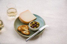 Plate Of Gouda Cheese And Olives