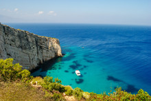 Zakynthos Island Coast Line, With Crystal Clear Waters And A Isolated Boat In Summer.