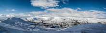 A Panoramic View Of The Peak District In Winter With Snow On The Mountains From A High Postion.