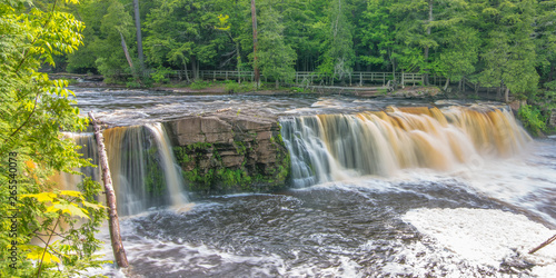 Beautiful waterfall at Porcupine Mountains Wilderness State Park in the Upper Peninsula of Michigan - smooth tranquil flowing water