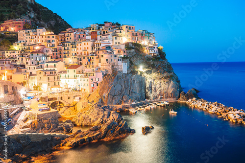 Obraz na plátně  Stunning view of the beautiful and cozy village of Manarola in the Cinque Terre Reserve at sunset