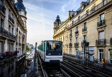 Streetcar Passing Between Apartment Buildings, Paris, France