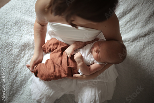 Photo  Older sister with baby 1 month, hugging newborn