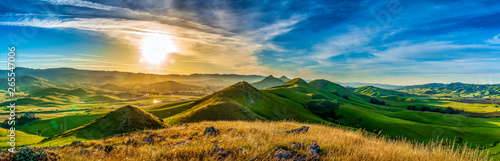 Acrylic Prints Grass Panorama of Hills of Grass at Sunrise