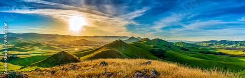 fototapeta na lodówkę Panorama of Hills of Grass at Sunrise