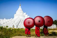Asian Monks Under Umbrellas Viewing Historic Temple, Mingun, Mandala, Myanmar