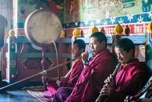 Asian Monks Playing Instrument...