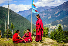 Asian Monks With Flag On Remot...