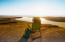 Lounge Chair On Beach Under Bl...