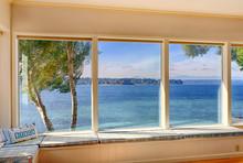 Windows To Ocean View In Modern Living Room