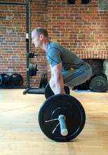 Caucasian Man Lifting Weights In Gymnasium