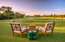 Chairs And Golf Balls On Driving Range