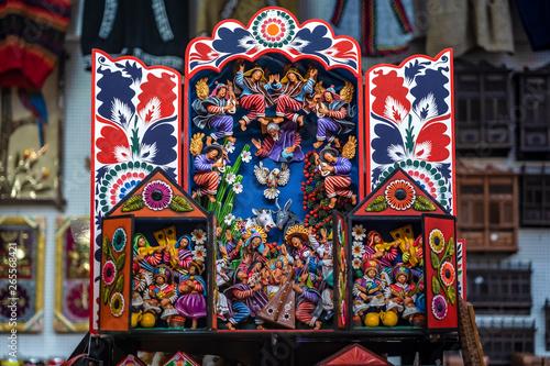 Fotomural Colorful Peruvian artisanal Retablo for sale at street Indian market in Miraflores, Lima
