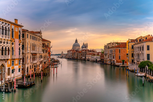 Fototapety, obrazy: Beautiful landscape sunset view of traditional Gondolas on famous Canal Grande with historic Basilica di Santa Maria della Salute in the background in romantic golden evening light at sunset in Venice