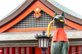 Fox statue of god at Fushimi Inari Taisha Shrine in Kyoto, Japan