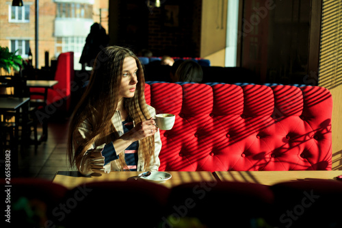 Stupendous Young Pretty White Girl In Casual Clothing Sits On A Red Squirreltailoven Fun Painted Chair Ideas Images Squirreltailovenorg