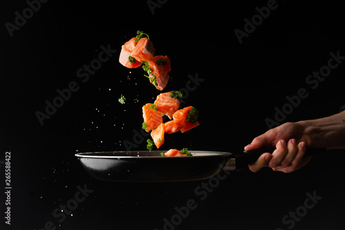 Sea food, cooking salmon with greenery, on a dark background, horizontal photo, healthy and wholesome food, Air freezing, cooking, menu, gastronomy, recipe book