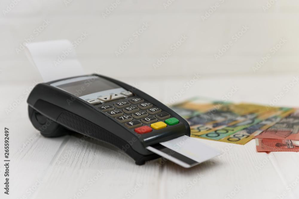 Fototapeta Australian dollar banknotes with terminal and credit card