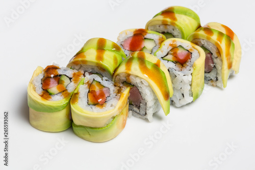 Fotografie, Tablou Salmon avocado sushi roll served on a plate