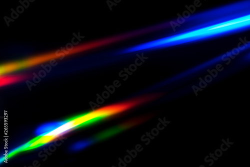 Fotobehang Fractal waves Abstract colorful spectrum in darkness. Colorful rays of light.