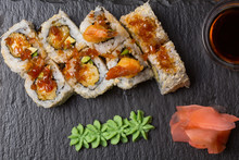 Smoked Salmon Roll Sushi Served On Blackstone