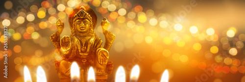 Fototapeta  diwali hintergrund mit statue lakshmi
