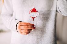 Close Uo Of Holding Christmas Decoration