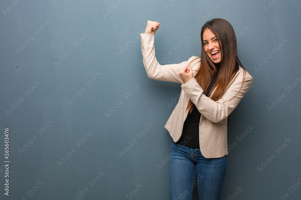 Fototapeta Young business woman who does not surrender