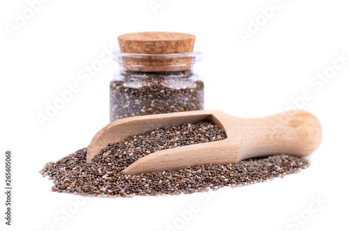 Chia Seeds In Glass Jar And Wooden Spoon Isolated On White