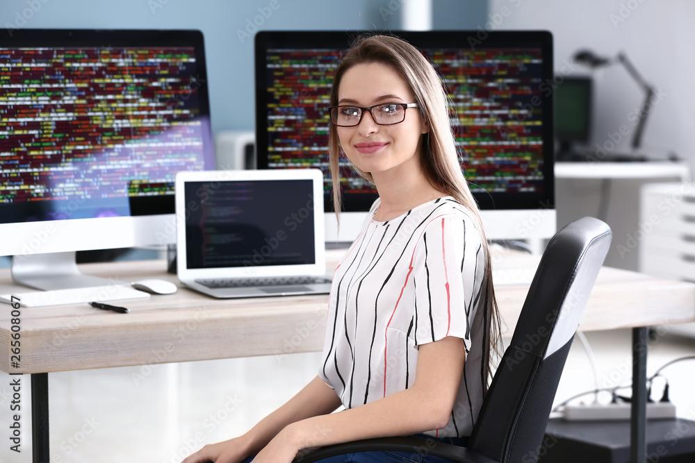 Fototapeta Portrait of female programmer in office