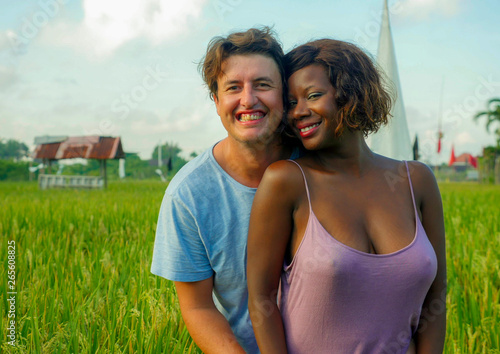 young happy and beautiful mixed ethnicity couple with black African American wom Tableau sur Toile