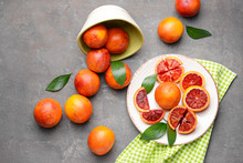 Fresh Blood Oranges On Grunge Background