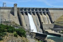 Folsom Dam In California With A Sluice Gaten Open..