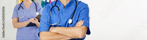 Fotografía  Female nurse and Doctor with stethoscope in the medical office with crossed arms clinic copy space