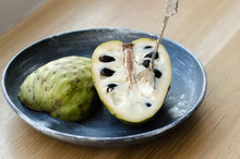 Cherimoya On The Black Plate On A Wooden Table