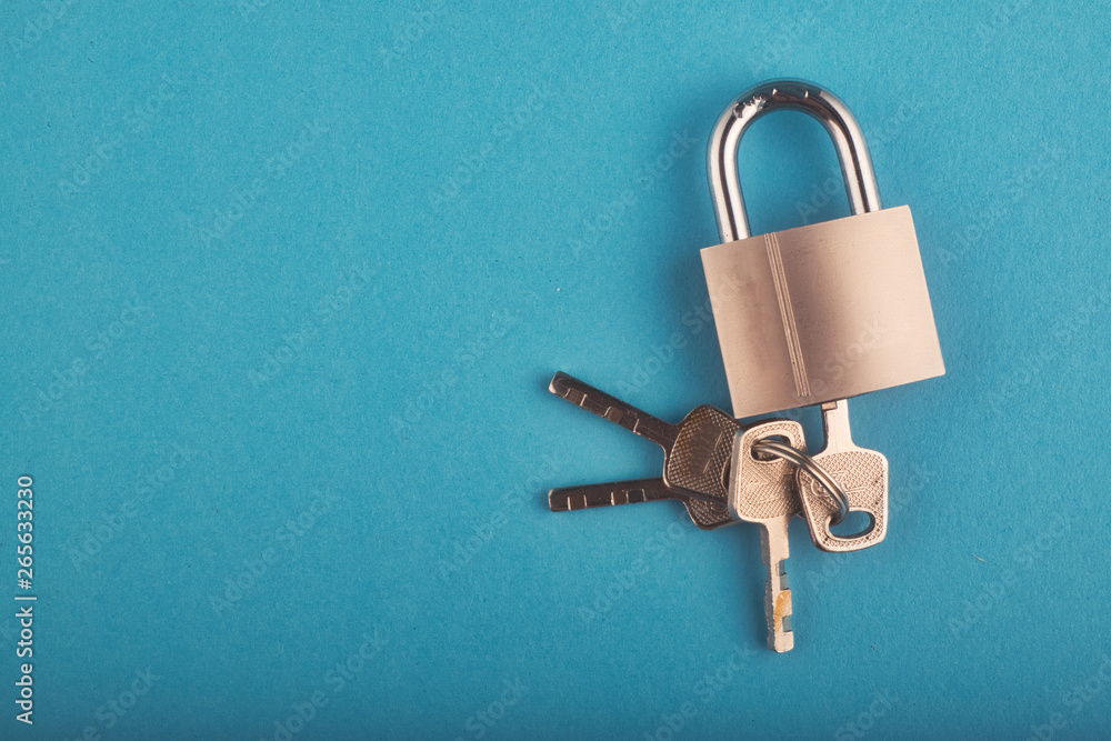 Fototapety, obrazy: locked Padlock and bunch of key on the blue background.copy space for text