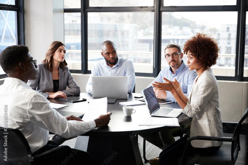 Fototapeta Millennial black businesswoman addressing colleagues at a corporate business meeting, close up