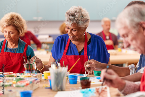 Leinwand Poster  Retired Senior Woman Attending Art Class In Community Centre