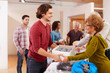 canvas print picture - People Donating Food To Charity Food Bank Collection In Community Center