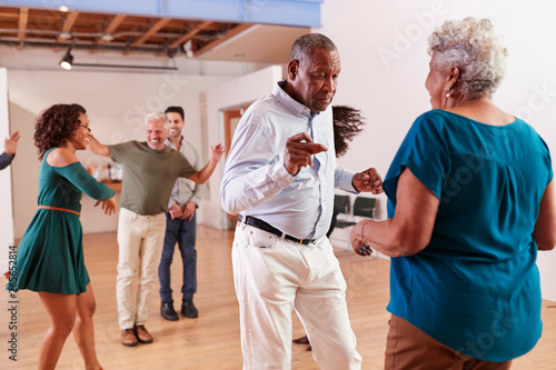 People Attending Dance Class In Community Center - 265652814