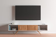 TV screen on the white wall in modern living room.