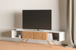 TV on the cabinet in modern living room on white wall background.
