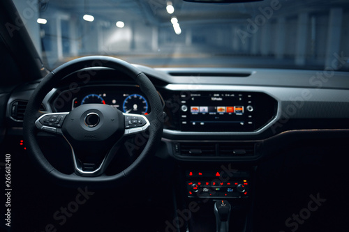 Photo Modern car interior with multimedia and dashboard at underground parking