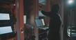 hacker in mask cracks the system in data centre