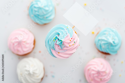 top view of delicious pink, white and blue cupcakes with sprinkles and blank car Wallpaper Mural